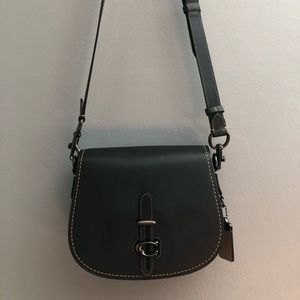 Black leather Coach saddle bag